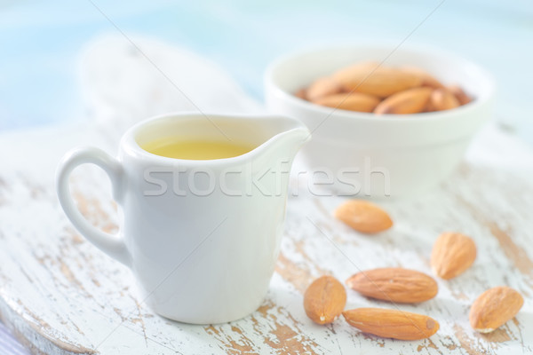almond essential oil and almond in bowl Stock photo © tycoon