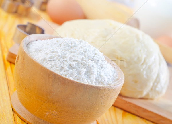 Flour in the wooden bowl Stock photo © tycoon