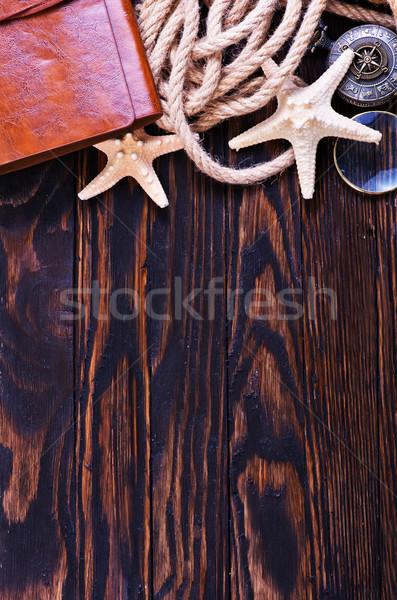 Viajar mesa de madeira caderno conchas mulher papel Foto stock © tycoon