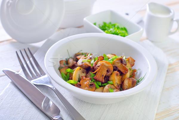 Sült gombák zöld olaj tányér csésze Stock fotó © tycoon