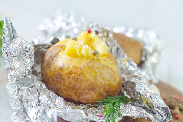 baked potato in foil Stock photo © tycoon