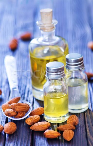 Amandel olie fles tabel medische vruchten Stockfoto © tycoon