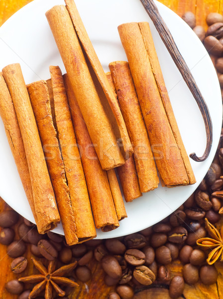 cinnamon and coffee on the white plate Stock photo © tycoon