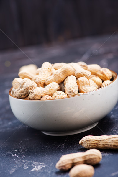 Amendoins tigela tabela fundo espaço escuro Foto stock © tycoon