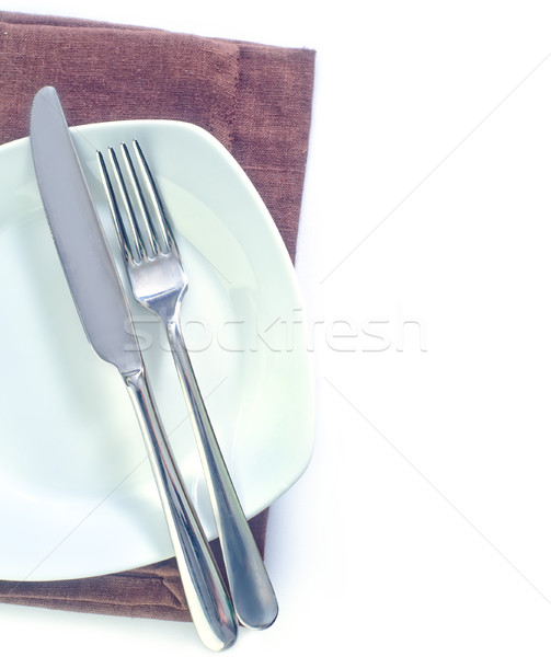 fork and knife on plate Stock photo © tycoon