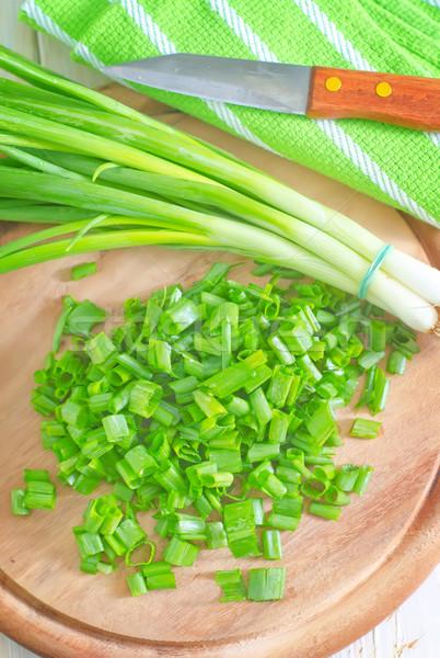 Yeşil soğan ahşap restoran tablo bıçak yeme Stok fotoğraf © tycoon