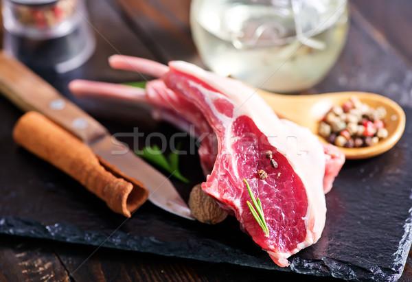 Surowy kotlet mięsa przyprawy tabeli obiedzie Zdjęcia stock © tycoon