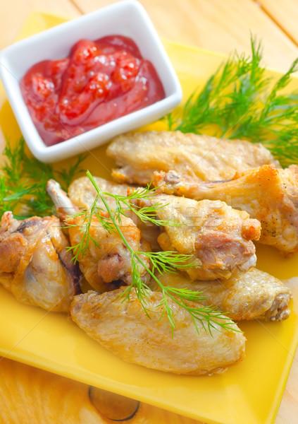 Caldo carne piatti pollo alla griglia ali rosso Foto d'archivio © tycoon