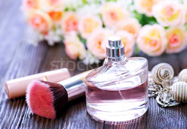 Parfüm çiçekler ahşap masa masaj dinlenmek şişe Stok fotoğraf © tycoon