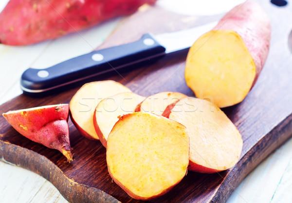 Patata dolce sfondo arancione rosso bianco mangiare Foto d'archivio © tycoon