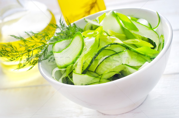 Fresh salad with cucumber and greens Stock photo © tycoon