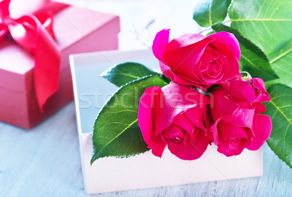 box for present and red roses  Stock photo © tycoon