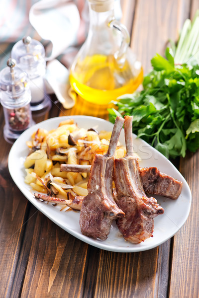 Rack of lamb fried with aromatic olive oil Stock photo © tycoon