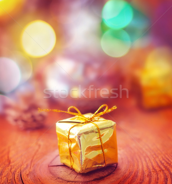 Gold present and cristmas decoration on the wooden board Stock photo © tycoon