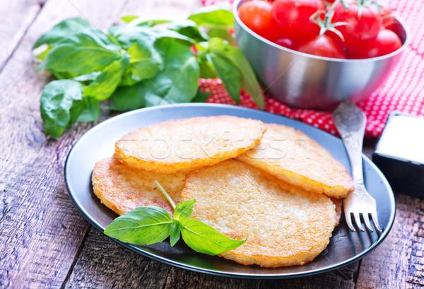 Aardappel pannenkoeken plaat tabel keuken diner Stockfoto © tycoon