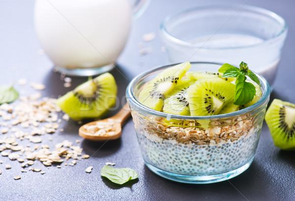 Lait semences kiwi bol lumière fruits Photo stock © tycoon