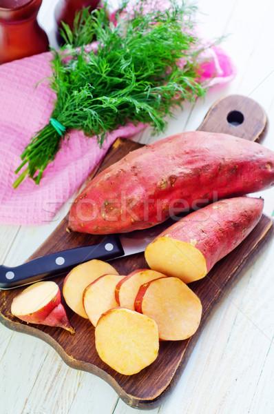 Zoete aardappel achtergrond oranje Rood witte eten Stockfoto © tycoon