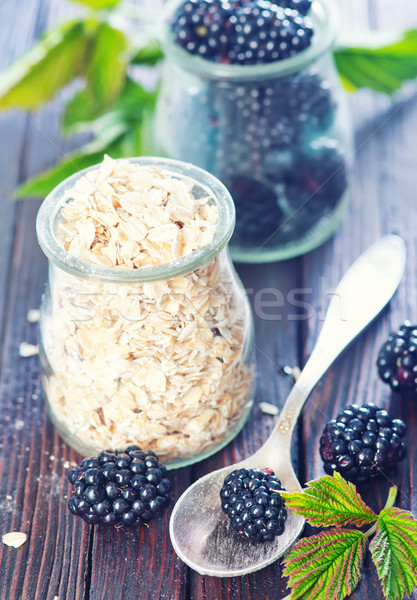oat flakes with black berries  Stock photo © tycoon