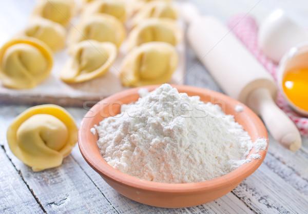 flour and raw pelmeni Stock photo © tycoon