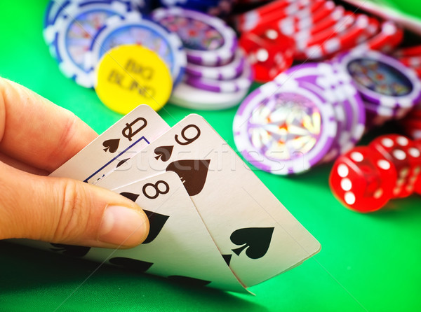 Card for poker in the hand, chips and card for poker Stock photo © tycoon