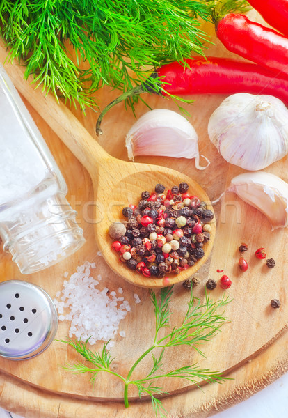 Aroma spice in the wooden spoon, spice and salt Stock photo © tycoon
