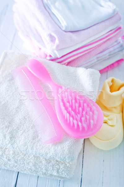 hairs brushes and baby clothes Stock photo © tycoon