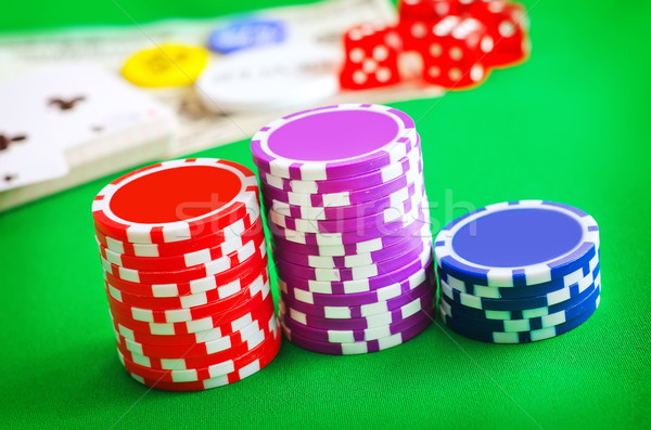 Group from chips for poker on the green background Stock photo © tycoon