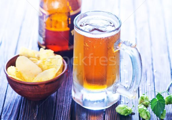 Friss sör üveg fa asztal fény ital Stock fotó © tycoon