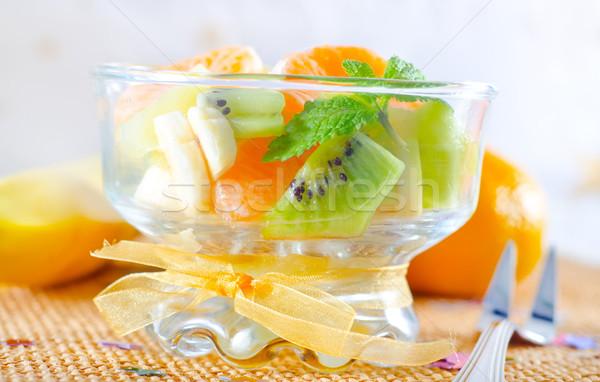 Vruchtensalade voedsel achtergrond groene Rood cocktail Stockfoto © tycoon