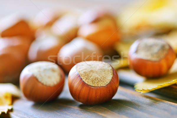 Mogyoró őszi levelek asztal étel csoport kagyló Stock fotó © tycoon