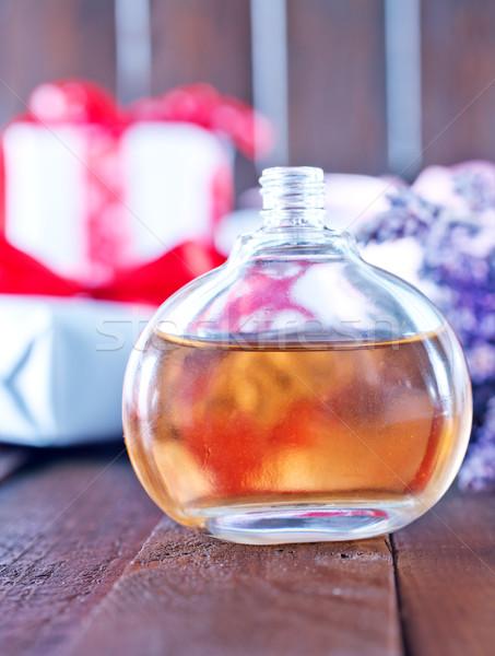 Parfüm üveg fa asztal víz divat üveg Stock fotó © tycoon