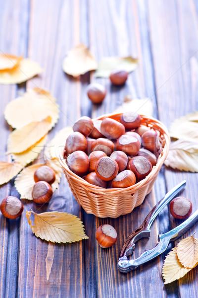 Mogyoró őszi levelek asztal levél háttér energia Stock fotó © tycoon