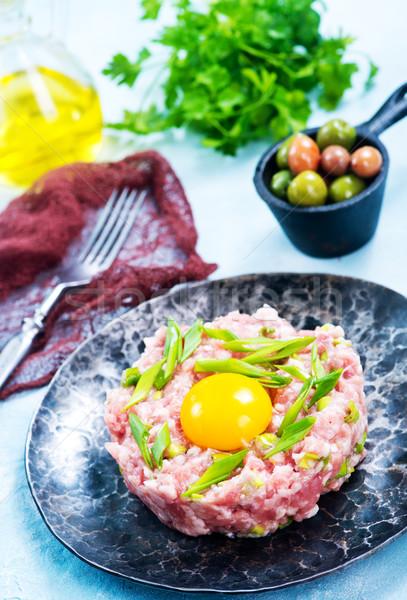 Carne Spice greggio tuorlo alimentare olio Foto d'archivio © tycoon