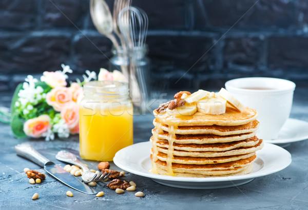 Pannenkoeken honing noten plaat voedsel achtergrond Stockfoto © tycoon