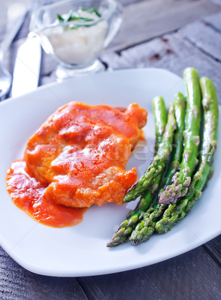 fried meat with sauce and asparagus Stock photo © tycoon
