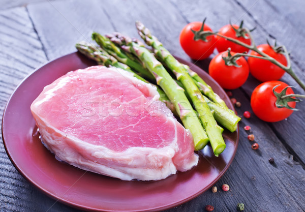 raw meat and asparagus Stock photo © tycoon
