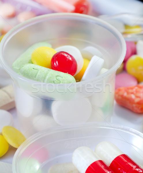 Color pastillas tableta médicos salud fondo Foto stock © tycoon