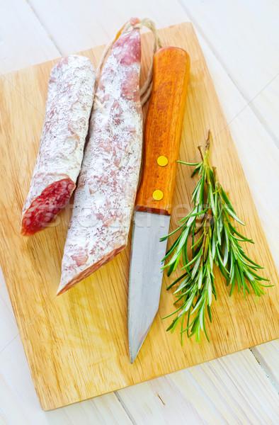 Salame comida vermelho carne conselho ervas Foto stock © tycoon
