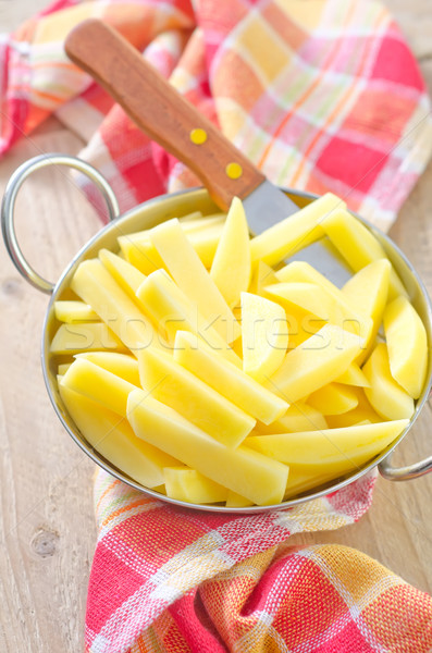 raw potato in metal bowl Stock photo © tycoon