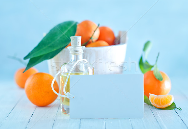 tangerines and oil in bottle Stock photo © tycoon