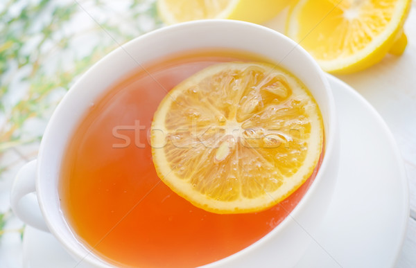 Fresh tea with lemon in the white cup Stock photo © tycoon