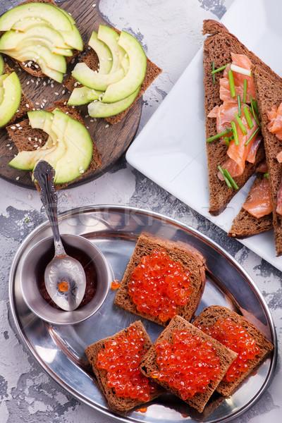 Kenyér piros lazac kaviár asztal víz Stock fotó © tycoon