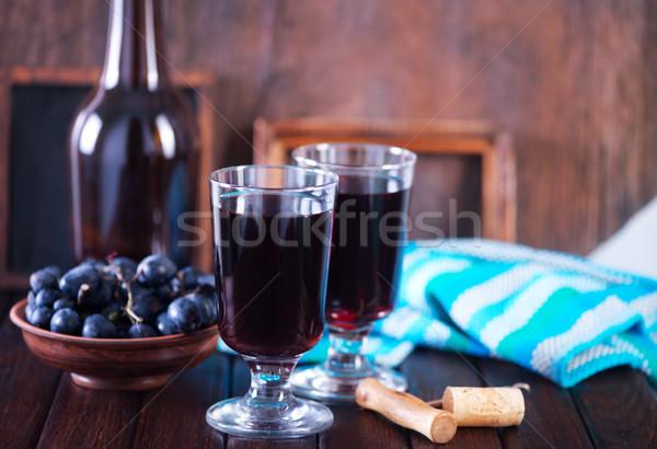 Raisins vin verre de vin table verre fond Photo stock © tycoon