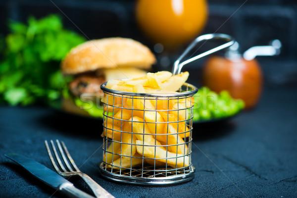 Fast food tabel hamburger aardappel voedsel restaurant Stockfoto © tycoon