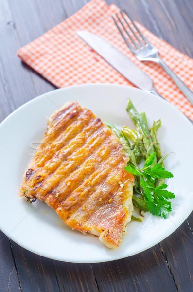 Sült hal zöldbab étel étterem zöld Stock fotó © tycoon