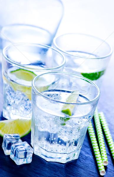 Agua limón vidrio mesa alimentos fiesta Foto stock © tycoon