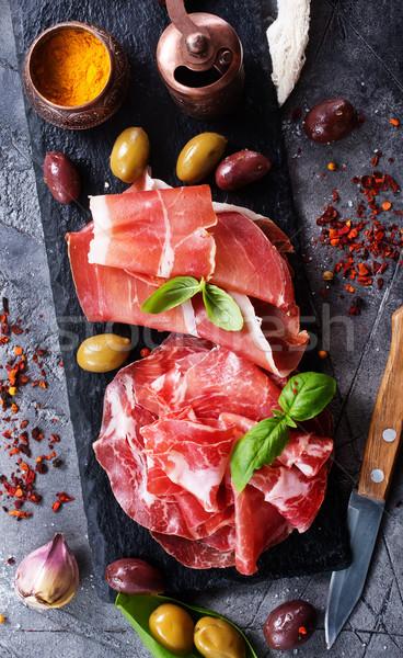 Prosciutto azeitonas tempero tabela comida fundo Foto stock © tycoon