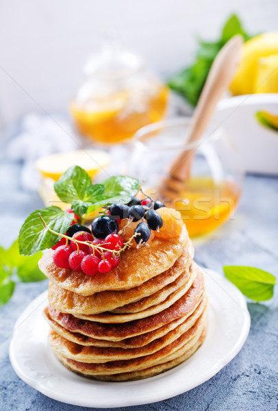 Pannenkoeken witte plaat tabel voedsel hout Stockfoto © tycoon