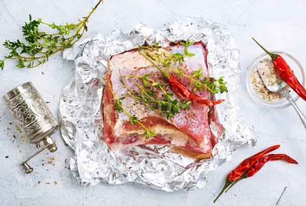 raw meat in foil Stock photo © tycoon