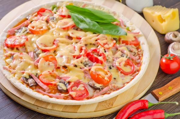 Pizza verde queijo vermelho preto tomates Foto stock © tycoon